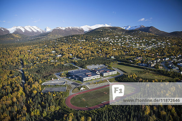 Aerial view of a school and nearby track field in autumn  Anchorage  Southcentral Alaska  USA