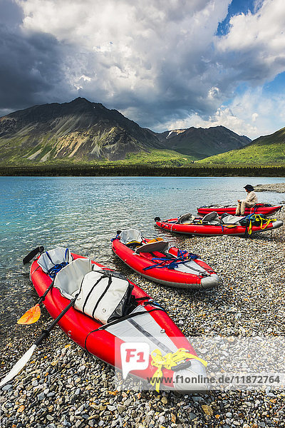 Kayaker and kayaks on the beach in the Twin Lakes area of Lake Clark National Park & Preserve  Southcentral Alaska  USA