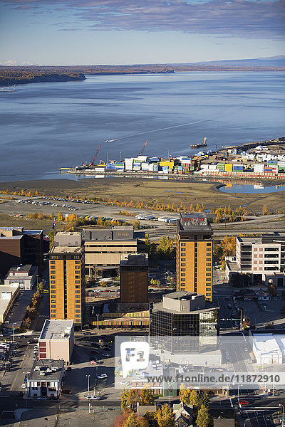 Aerial View of the Captian Cook hotel in downtown Anchorage with Cook Inlet and the port in the background  Southcentral Alaska  USA