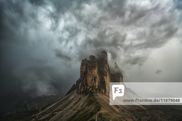 'A large thunderstorm looms over Tre Cime in Natural Park Tre Cime in the Italian Dolomites; Italy'