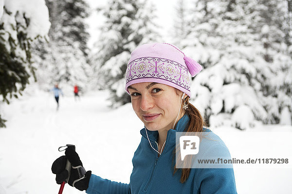 'A young woman cross country skiing  Ohlson Mountain; Alaska  United States of AmericaNone'