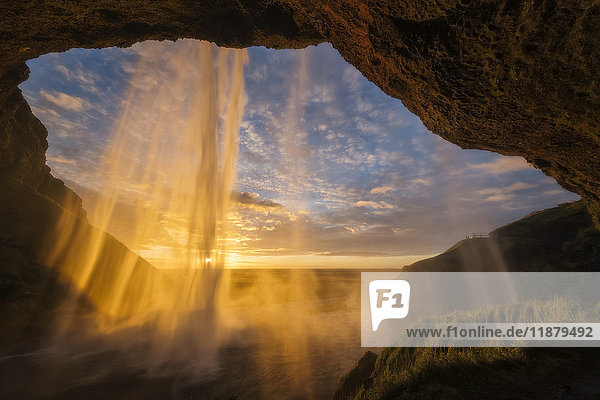 'Sunset light shines through the water of Seljandefoss along the South coast; Iceland'