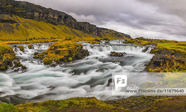 'Glacial river along the road on the south coast of Iceland; Iceland'