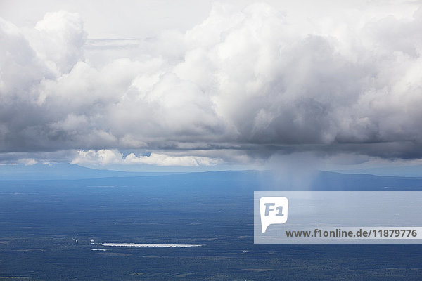 'A storm cloud over the blue ocean water with rain falling  Matanuska-Susitna Borough; Alaska  United States of America'