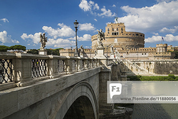 'Saint Angelo bridge over the Tiber river and The Mausoleum of Hadrian  also called the Saint Angelo Castle; Rome  Italy'