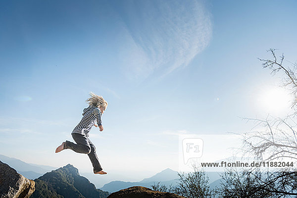 Boy jumping  blue sky in background  Sequoia National Park  California  US