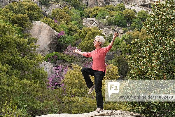 Senior woman doing yoga  Sequoia National Park  California  US