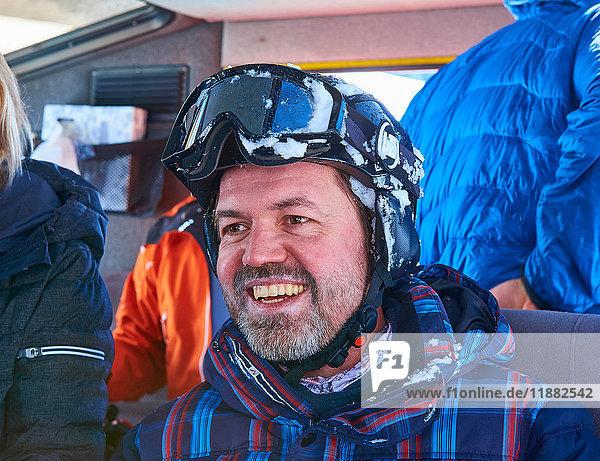 Happy mature male skier in snow coach  Aspen  Colorado  USA