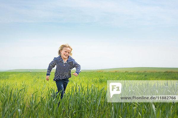 Boy running in grass