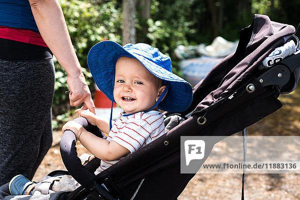Baby boy sitting in pram
