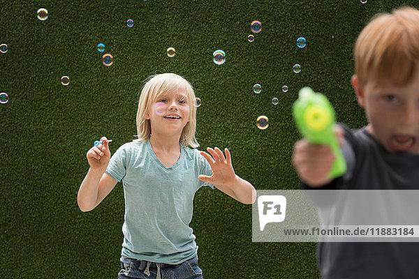 Boys using bubble maker