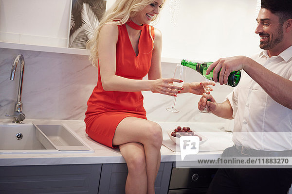 Couple sharing a bottle of champagne