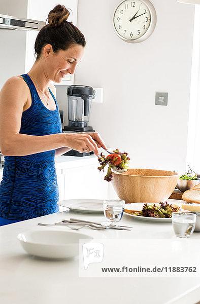 Woman preparing salad lunch
