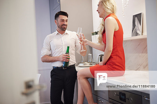 Couple sharing a bottle of champagne  making a toast