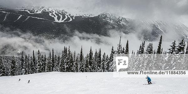 'Downhill skiiers at a ski resort; Whistler  British Columbia  Canada'