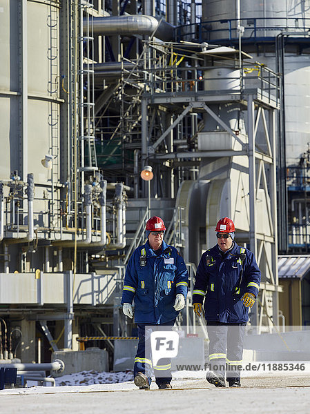'Two tradesman walking together at a refinery; Edmonton  Alberta  Canada'