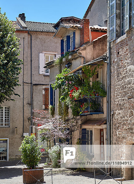 Europe  France  Occitanie  Lot  Cahors city  the old city  timber framed and brick buildings and square in medieval town  Balcony with flowers