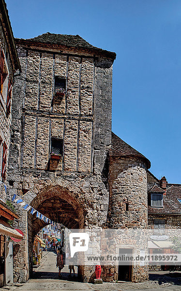 Europe  France  Occitanie  Lot  Rocamadur city  Tourist shops and the gate Salmon in the medieval centre of Rocamadur