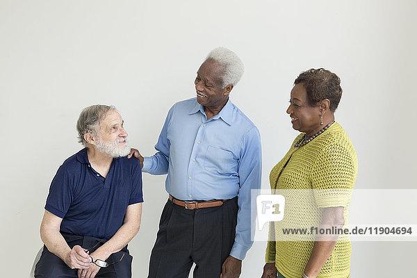 Older couple talking to friend