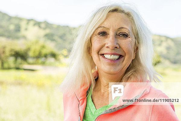 Portrait of smiling Older Caucasian woman outdoors