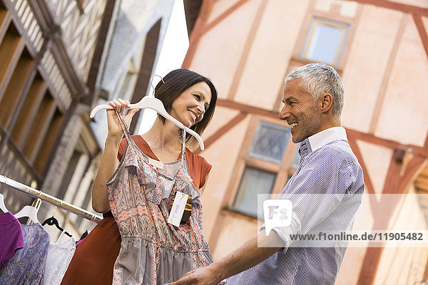Caucasian woman asking man for advice about dress