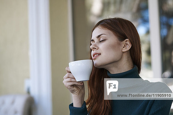 Caucasian woman relaxing and drinking coffee