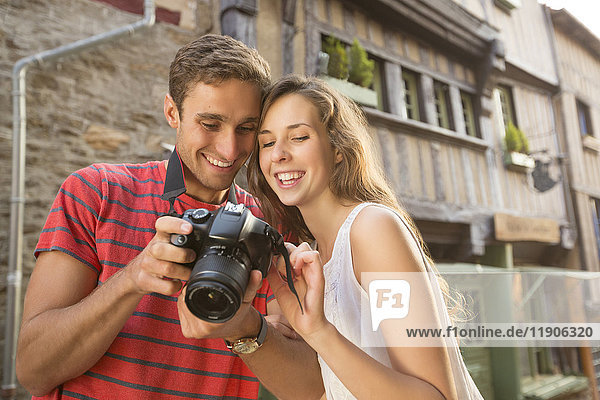 Caucasian couple examining the camera