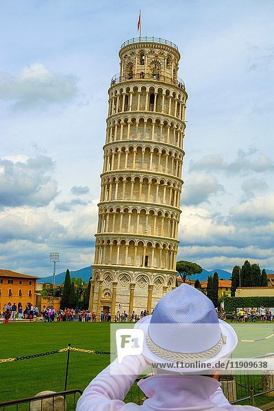Tourist posing in front of Duomo and Leaning Tower of Pisa  Italy.