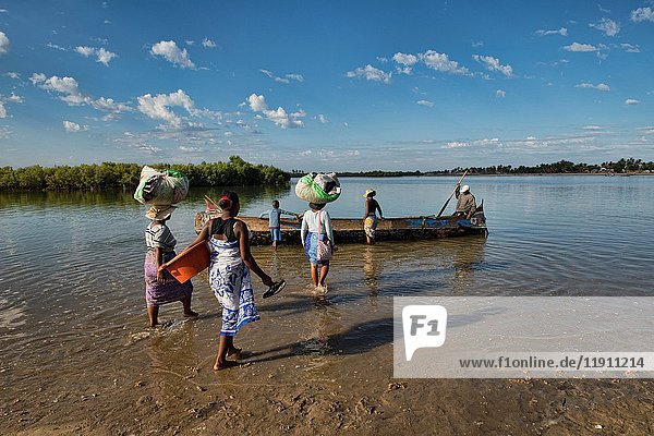 Ferry crossing by pirogue on an inlet off the Indian Ocean  Morondava  Madagascar.