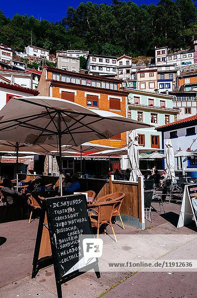 Village houses and restaurant terraces  Cudillero  Asturias  Spain