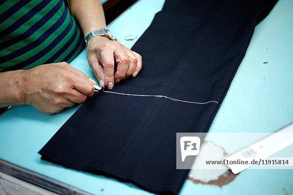 A tailor works in Sastrería Jimenez tailoring shop  Colonia Roma  Mexico City  Mexico.