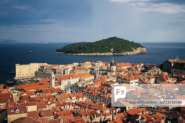 Croatia  Dalmatia  Dalmatian Coast  Dubrovnik  historical centre listed as World Heritage by UNESCO  city rooftops and the dome of the Assumption cathedral  Lokrum island in the distance