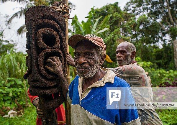 Ni-Vanuatu statue carvers working in the forest on a fern tree  Malampa Province  Malekula Island  Vanuatu.