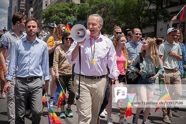 U. S. Senator Charles Schumer marches in the annual Lesbian  Gay  Bisexual  Transgender and Queer (LGBTQ) Pride Parade on Fifth Avenue in New York on Sunday  June 25  2017. Besides the corporate sponsors  politicians and various social service groups many participants carried political themed signs showing their dissatisfaction with President Trump.