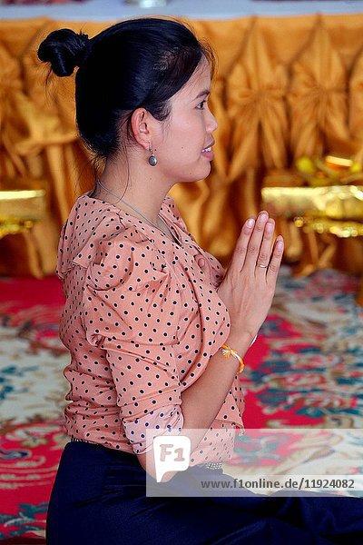 Lao woman praying.