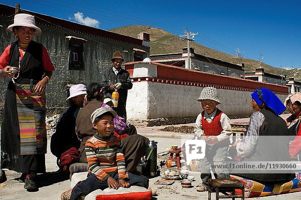 A family celebrates the graduation of a relative in the village of Bainans  located along the road separating Shigatse from Gyantse  Tibet  China.
