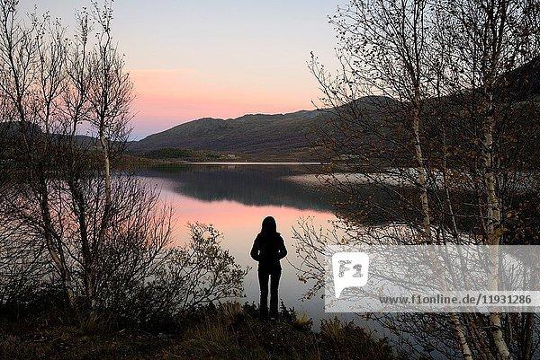 Norway  Oppland  Vaga  Jotunheimen National Park  the lake of Ovre Sjodalsvatnet at sunset  Model Released