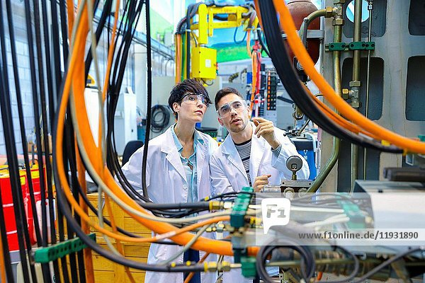 Researchers in machining center  Industry  Tecnalia Research & innovation  Technology and Research Centre  Miramon Technological Park  San Sebastian  Donostia  Gipuzkoa  Basque Country  Spain  Europe.