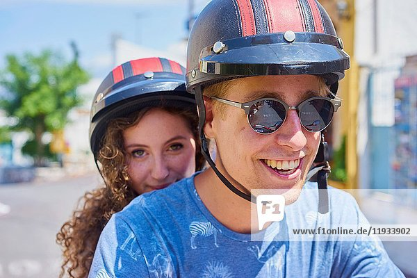 Happy young couple enjoying road trip