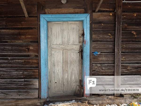Poland. Blue door in a wooden house