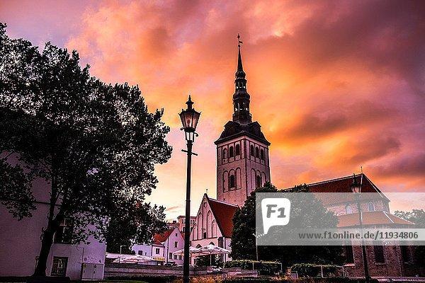 Sunset over St. Olaf's church in Tallinn  Estonia.