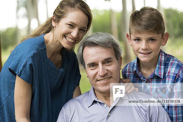 Family smiling together  portrait