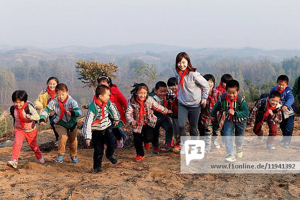 Rural female teachers and students play