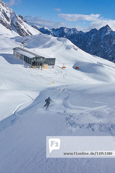 Germany  Bavaria  Zugspitz Arena  man skiing off-piste