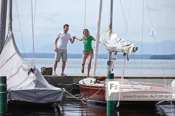 Germany  Bavaria  Lake Starnberg  couple at sailboat