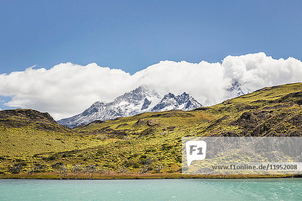 Clouds over snow capped mountain  Torres del Paine National Park  Chile
