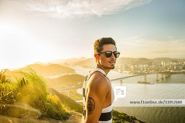 Man at view point during sunset  Rio de Janeiro  Brazil