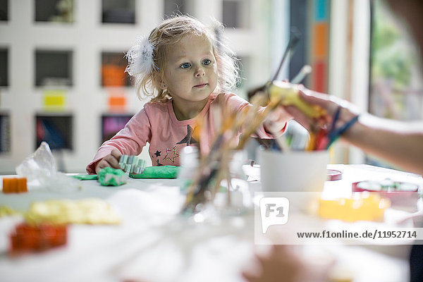 Girl playing with clay