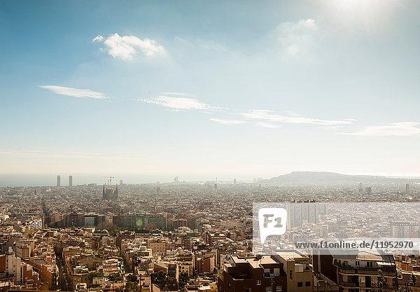 Elevated cityscape view with La Sagrada Familia and distant coast  Barcelona  Spain