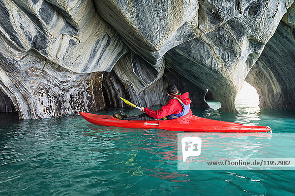 Man kayaking around marble caves  Puerto Tranquilo  Aysen Region  Chile  South America